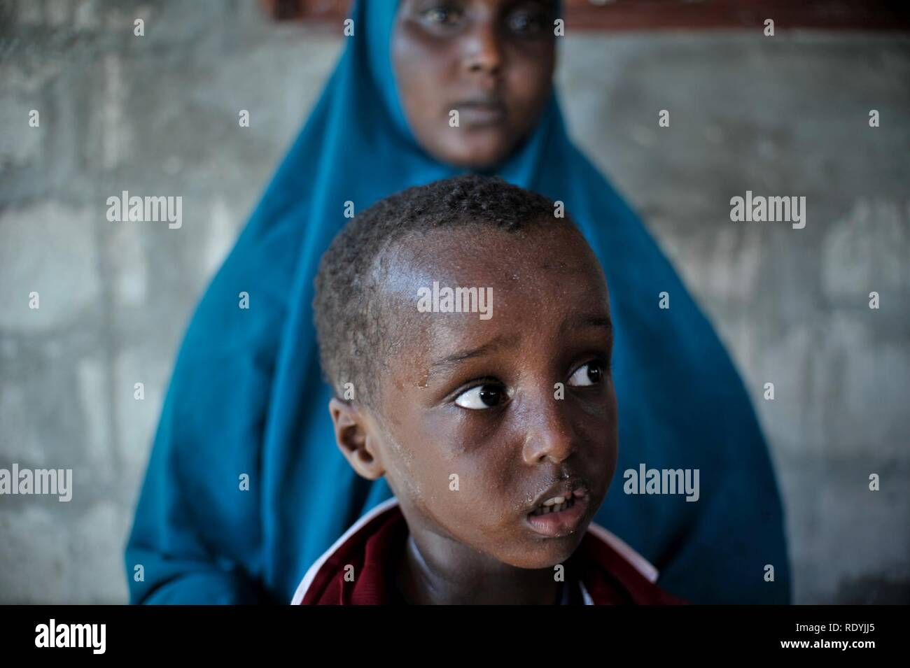 At a clinic held at Jazeera Training Camp on April 6, patients come to a free medical clinic in order to receive treatment for a variety of maladies. Many of the clinic's patients come from Jazeera (8634147104). - Stock Image