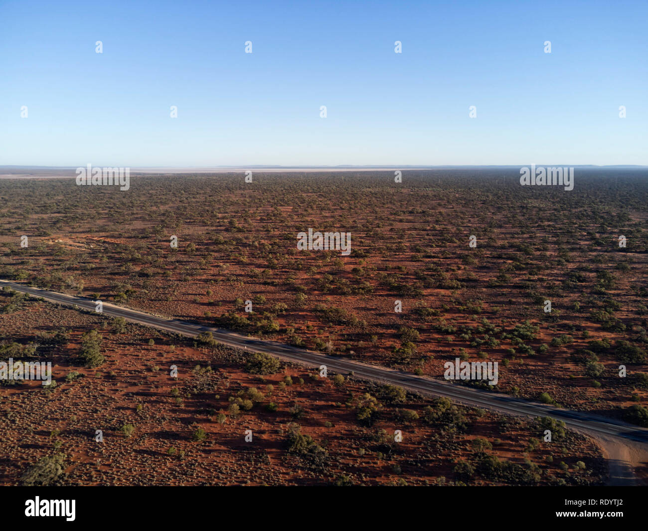 Aerial of the Stuart Highway as it passes through the arid environment of southern South Australia - Stock Image