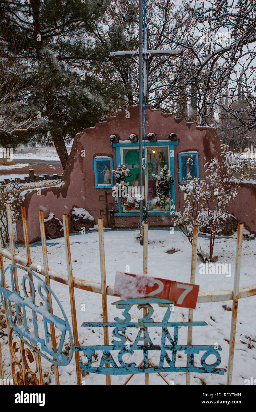 Snow covers a religious shrine in the Mesilla Valley of New Mexico following a Winter Storm Stock Photo