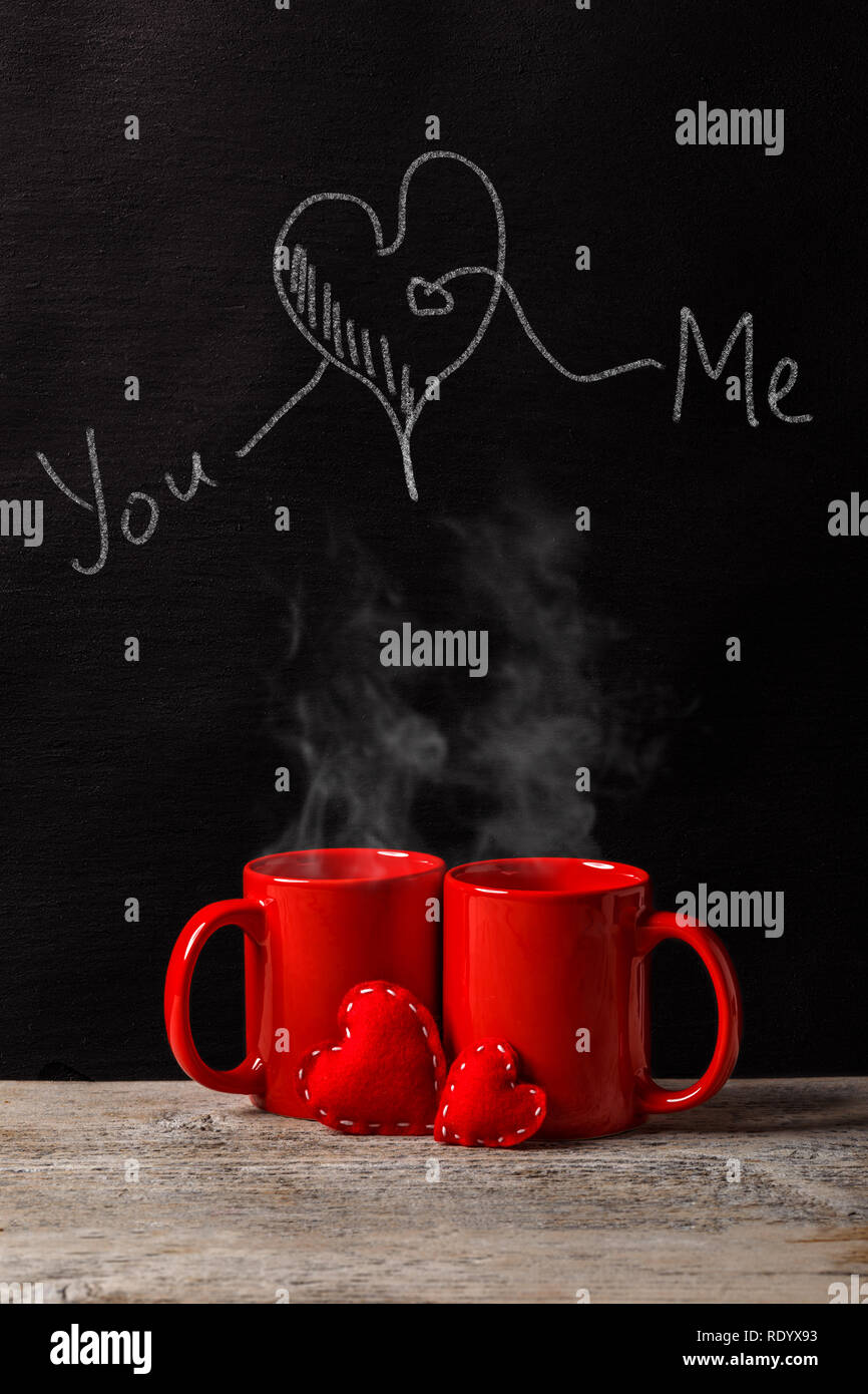Creative Love or Valentine's Day Concept with Heart, You, Me drawing on a chalkboard - Stock Image