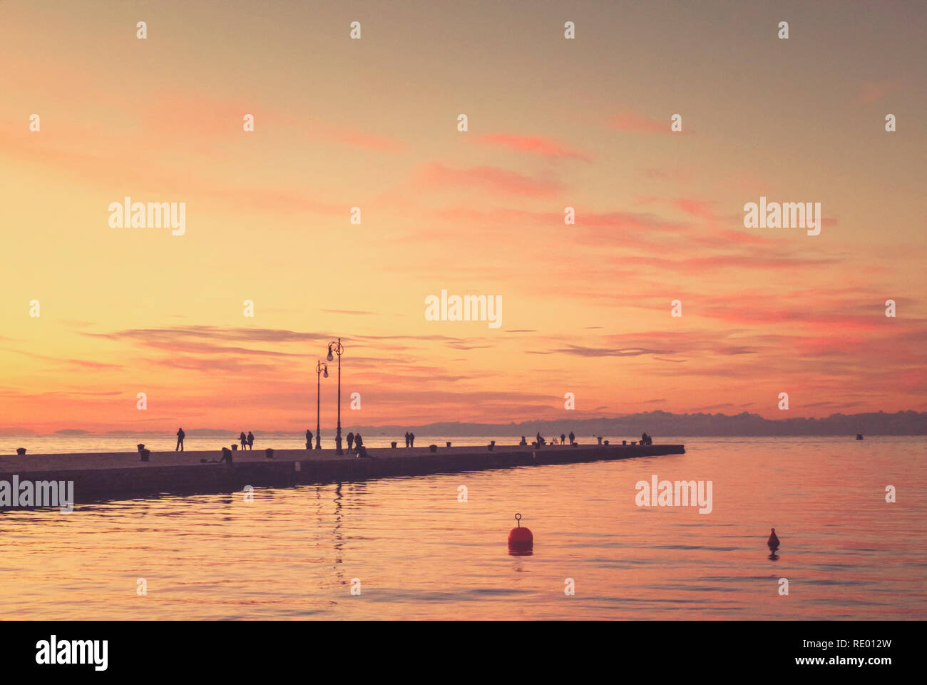 Trieste. Sunset over the Molo Audace. - Stock Image