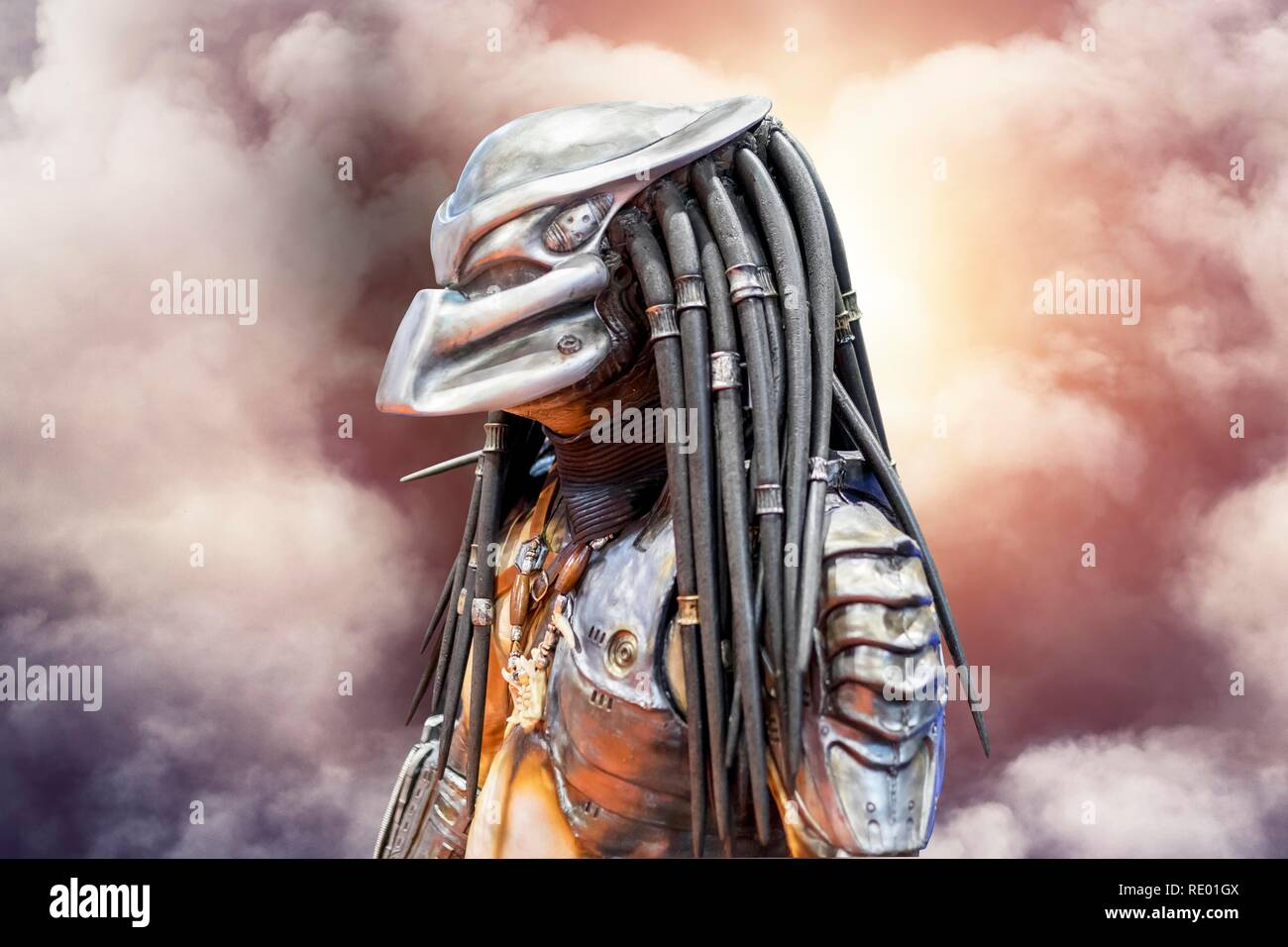 Birmingham, UK - March 17, 2018. Male comicon fan dressed as Twentieth Century Fox character, Predator in cosplay fancy dress at a comic convention. - Stock Image