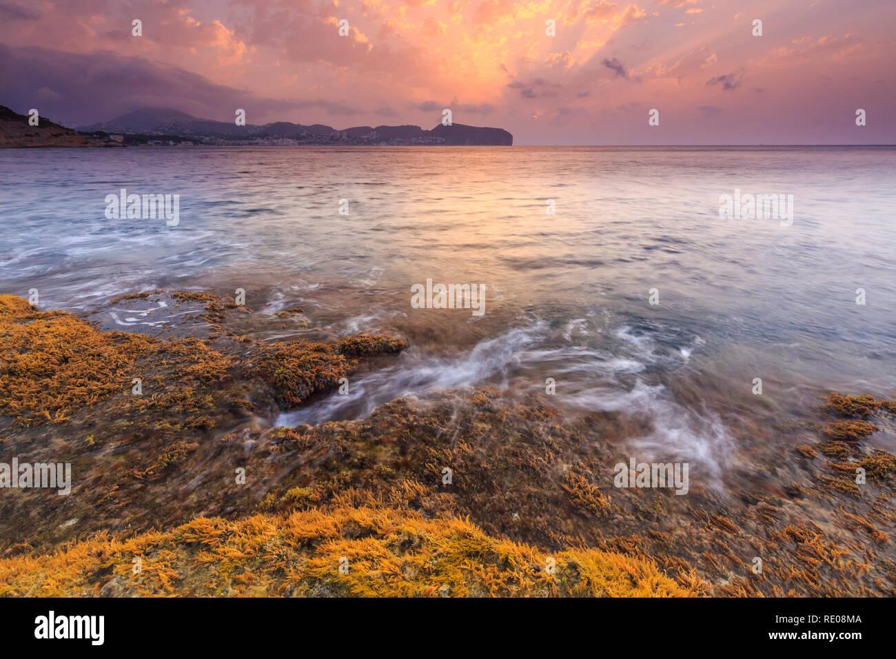 Sunrise at Cap Blanc in Moraira, with cap d'Or view, Teulada Moraira, Alicante, Costa Blanca, Comunidad Valenciana, Spain, Europe. - Stock Image