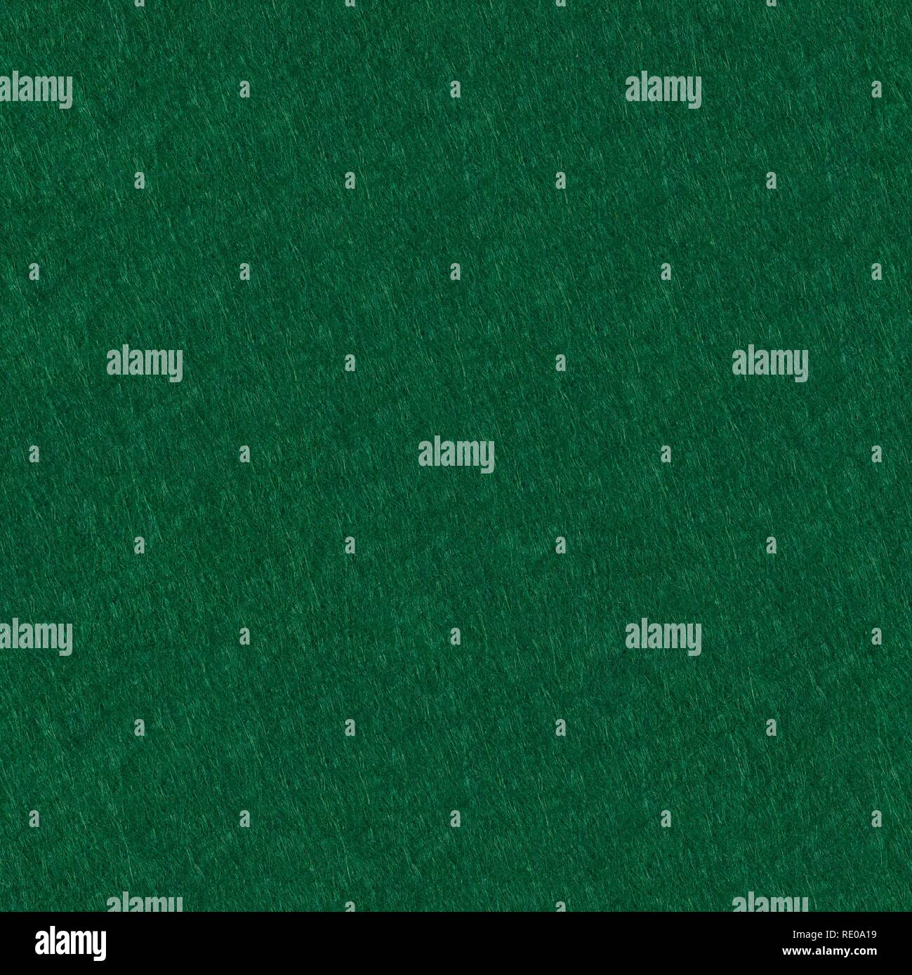 Poker table felt background in green color. Seamless square texture, tile ready. - Stock Image