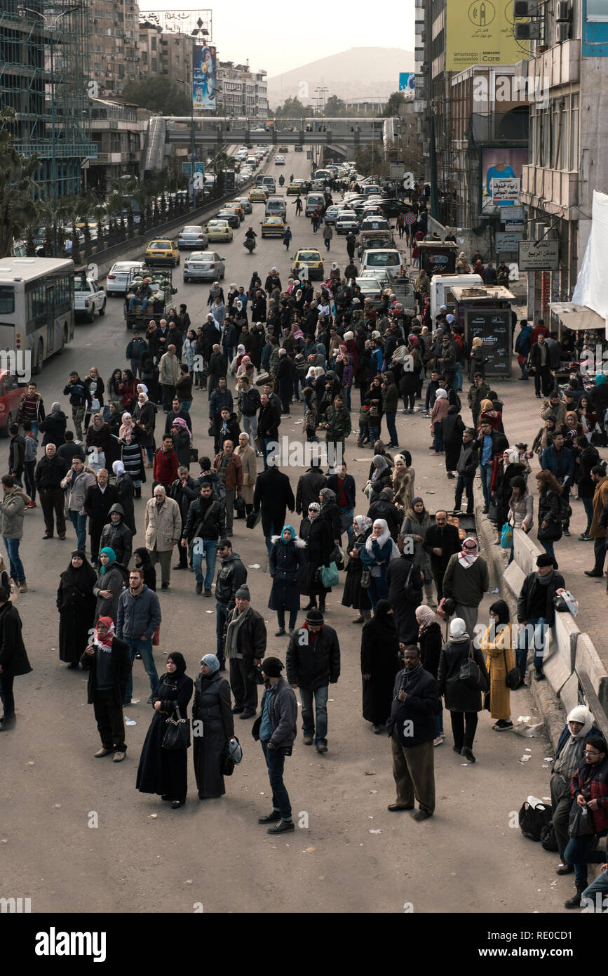 Some Photos show how difficult to get a public transportation in Damascus - Stock Image