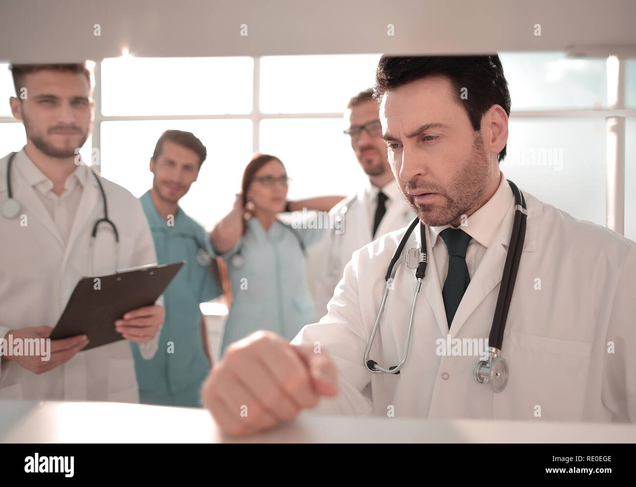 Scientist in uniform doing tests in laboratory - Stock Image