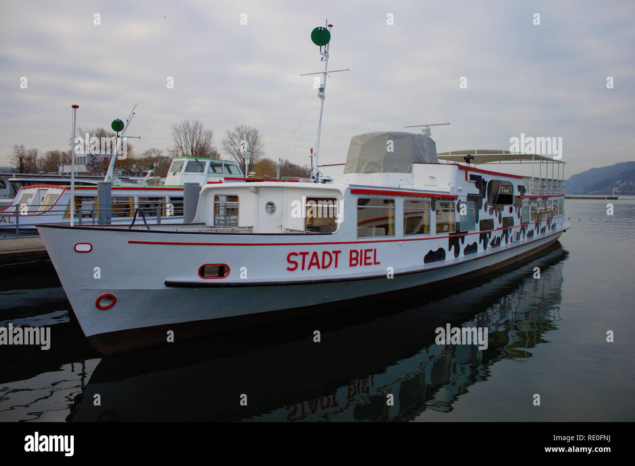 Passenger boat of Bielersee Schifffahrts Gesellschaft. Stadt Biel. Laying at the harbor of Biel during winter. - Stock Image