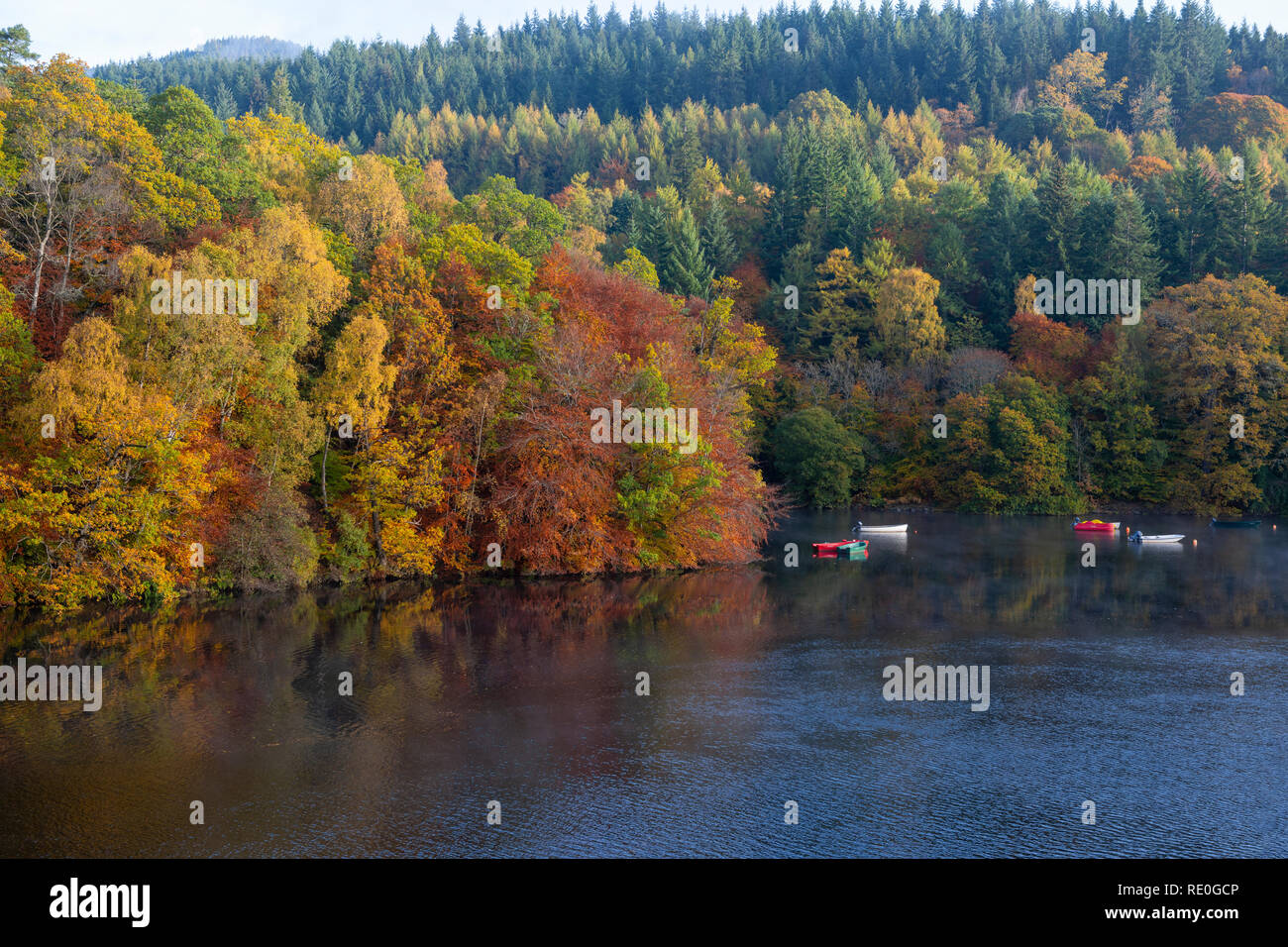 Colourful boats on Loch Faskally near Pitlochry, Perthshire, Scotland - Stock Image