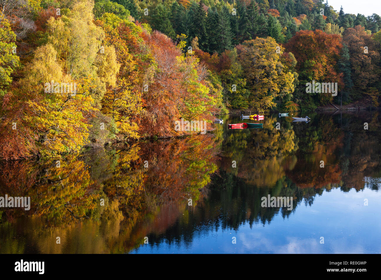 Colourful boats on Loch Faskally near Pitlochry, Perthshire, Scotland Stock Photo