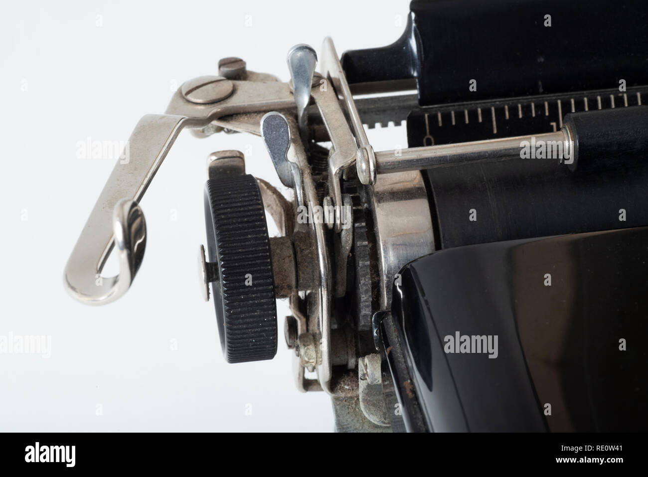 Close up of the return carriage and rotation knob on a 1950s-era Royal typewriter. - Stock Image