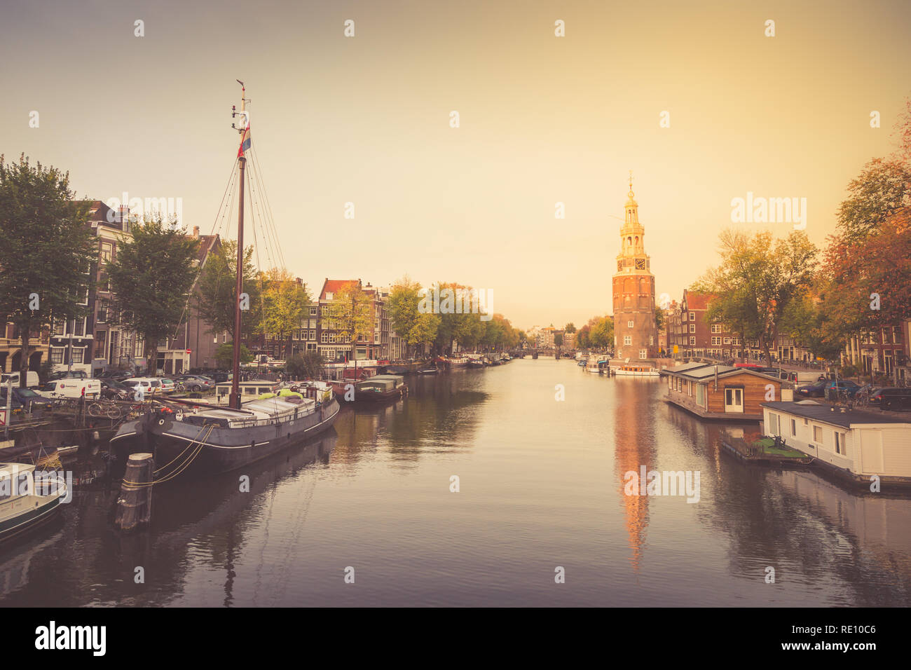 Typical view of canal embankment in historic center of city, Amsterdam, Netherlands Stock Photo