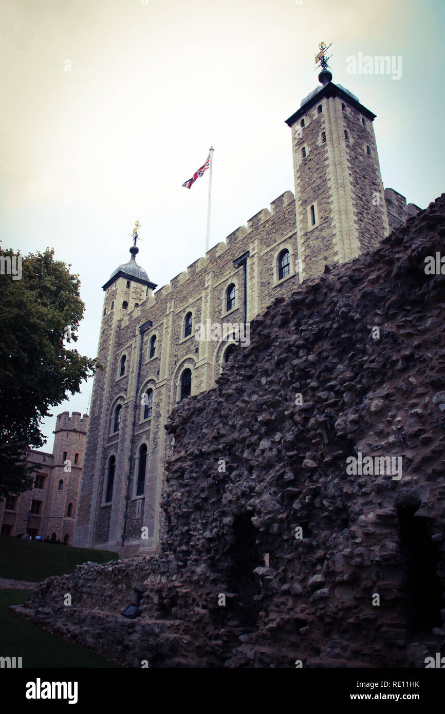 Union Jack at the White Tower inside Her Majesty's Royal Palace and Fortress of the Tower of London, United Kingdom - Stock Image
