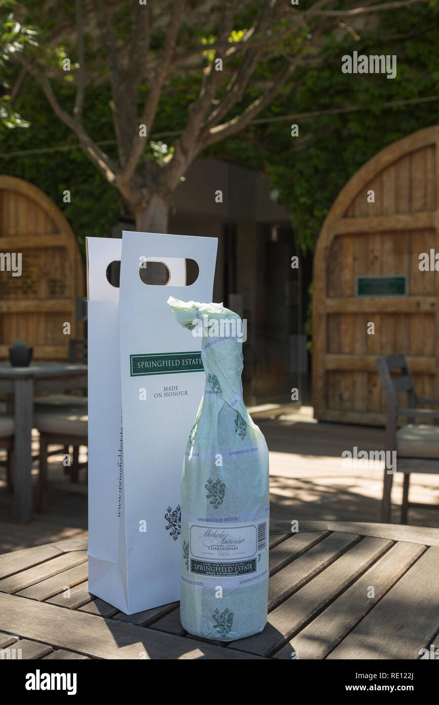 Springfield Wine Estate, Robertson, Route 62, Breede River Valley, Western Cape, South Africa. Bottle of wine in packaging outside the cellars - Stock Image