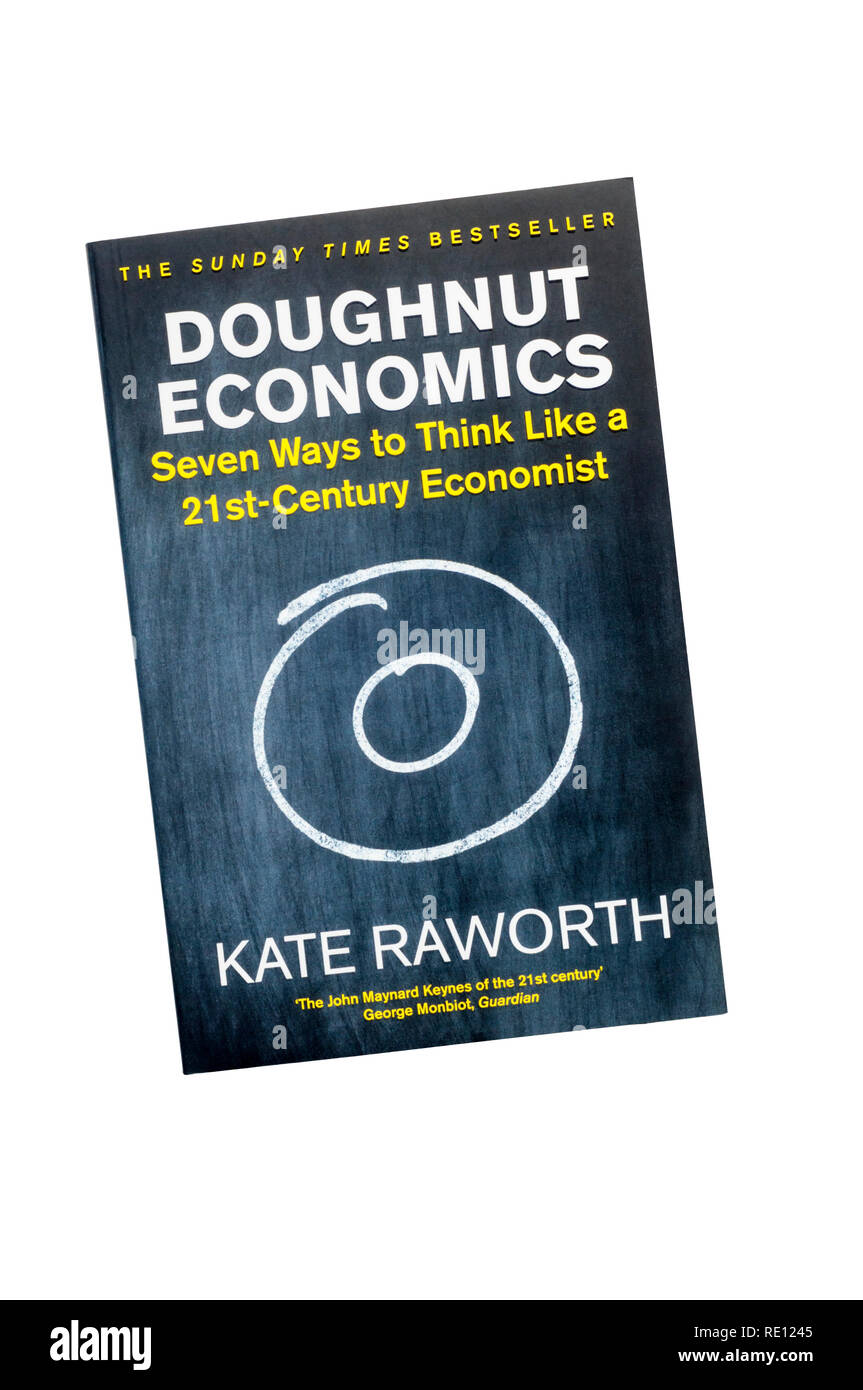 Paperback copy of Doughnut Economics by Kate Raworth. First published in 2017. - Stock Image