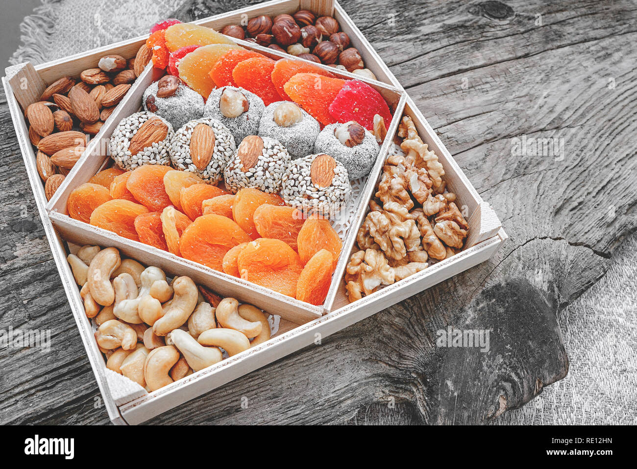 Turkish delight oriental sweets dried fruits and nuts in a wooden box. Background. Healthy vegan food. Natural food. Selective focus. Copy space. Stock Photo