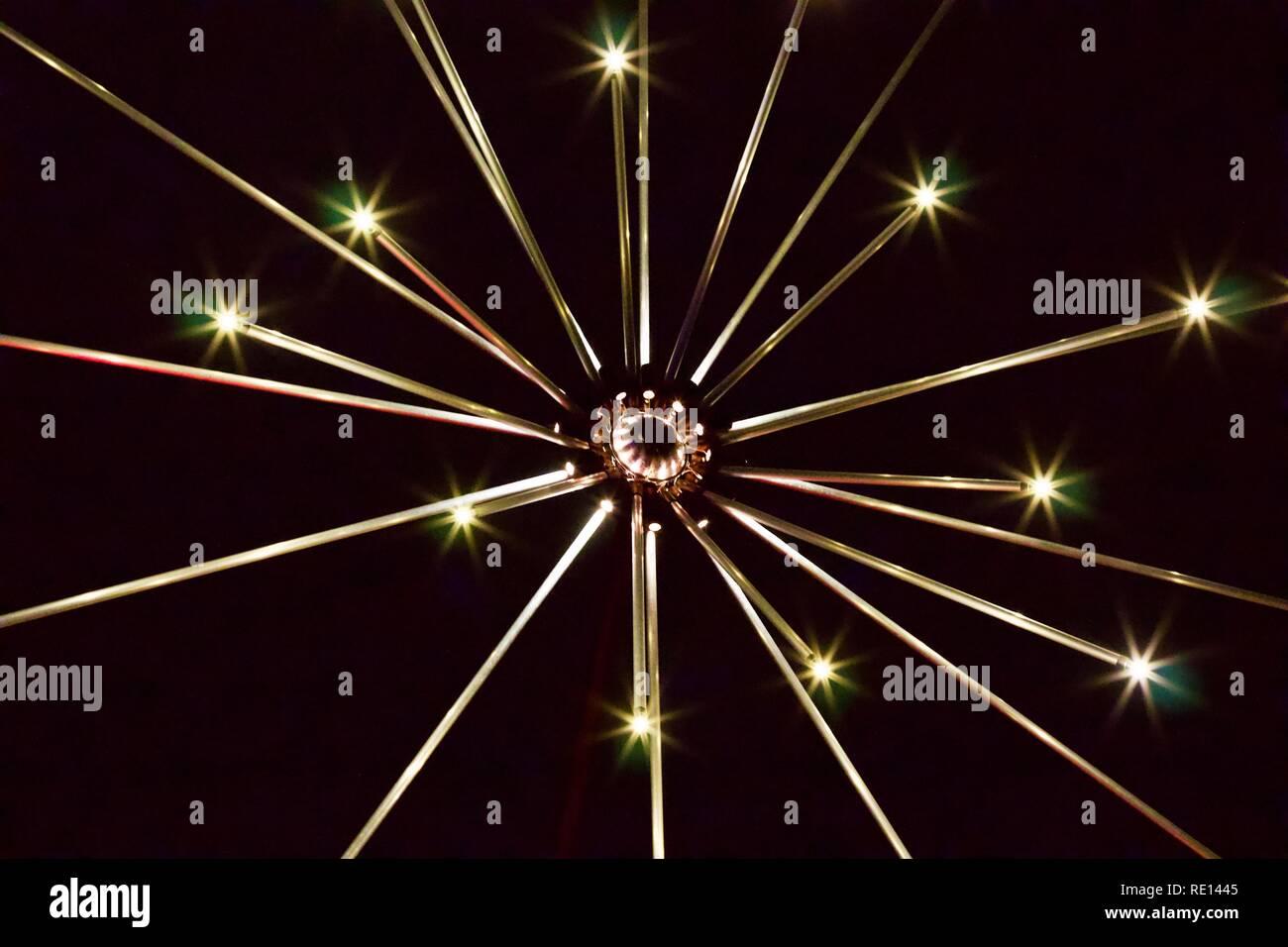 Closeup of a snowflake sculpture made of sparkling lights at Christmas at Kew Gardens 2018 - Stock Image