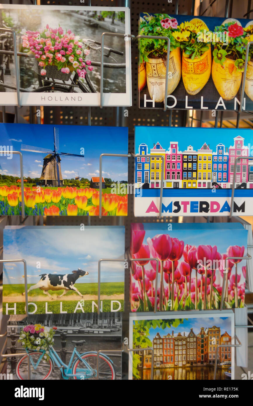 Colourful postcards of Holland and Amsterdam on sale at Schiphol Airport. - Stock Image