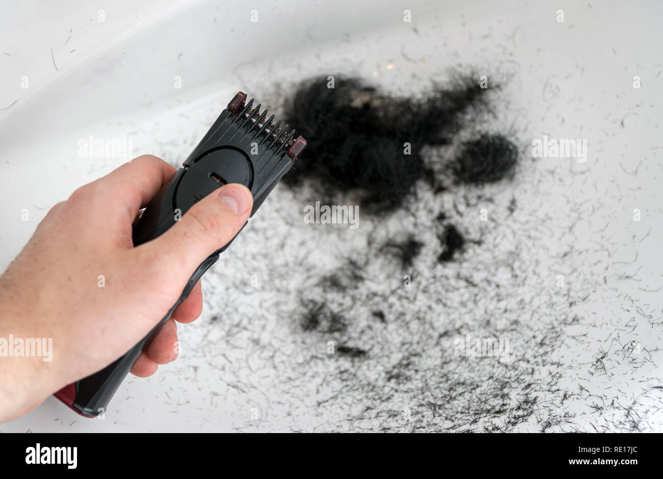 A man after trimming his beard, with the mess left. - Stock Image