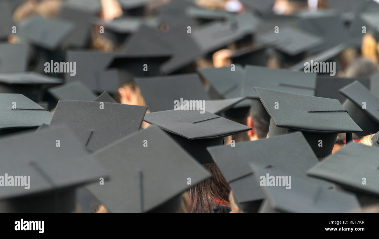 A see of graduation caps at a graduation ceremony. - Stock Image