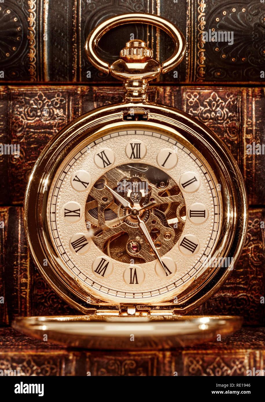 Antique clock dial close-up. Vintage pocket watch. - Stock Image