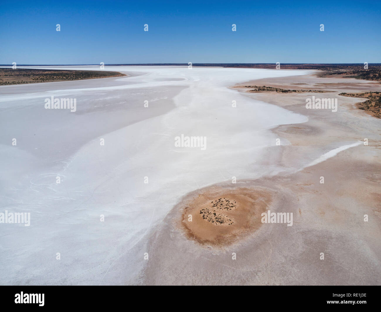 Aerial of the patterns on a salt encrusted lake known as island lagoon in the South Australian outback - Stock Image