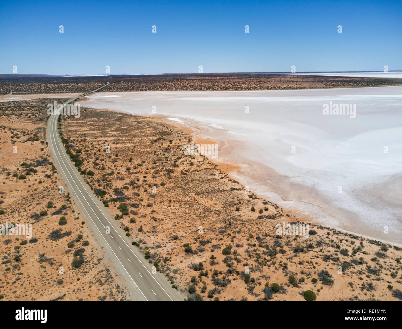 Aerial of the Stuart Highway as it passes salt lakes in the South Australian outback. - Stock Image