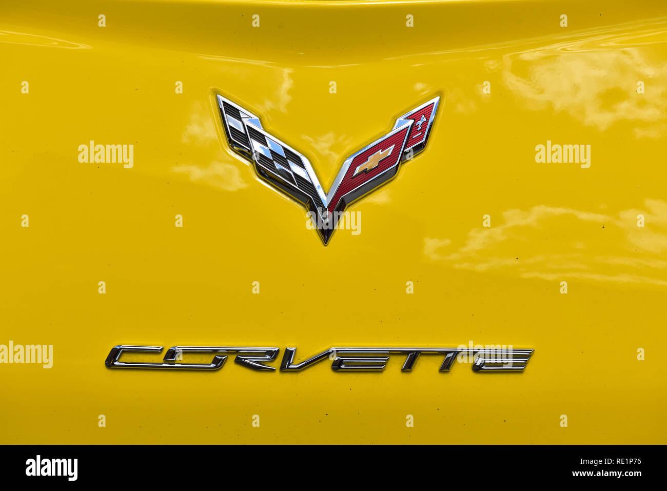 Chevrolet Corvette logo on yellow Corvette - Stock Image