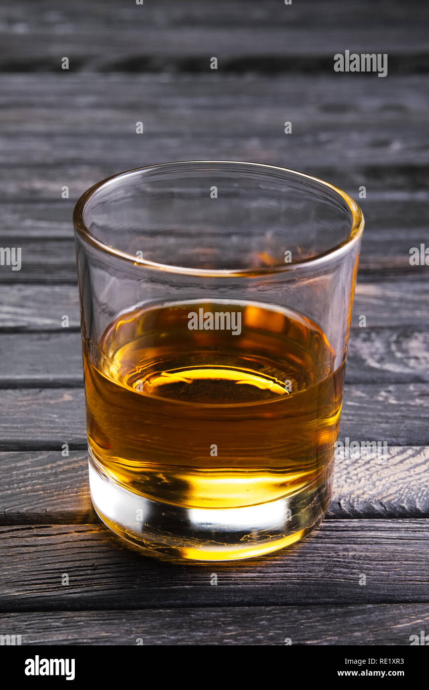 Glass of self-made pepper moonshine - Stock Image