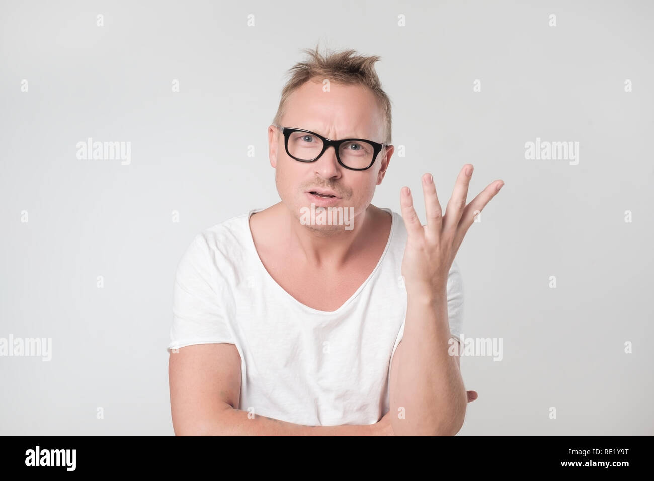 Young caucasian man is defending his point of view - Stock Image