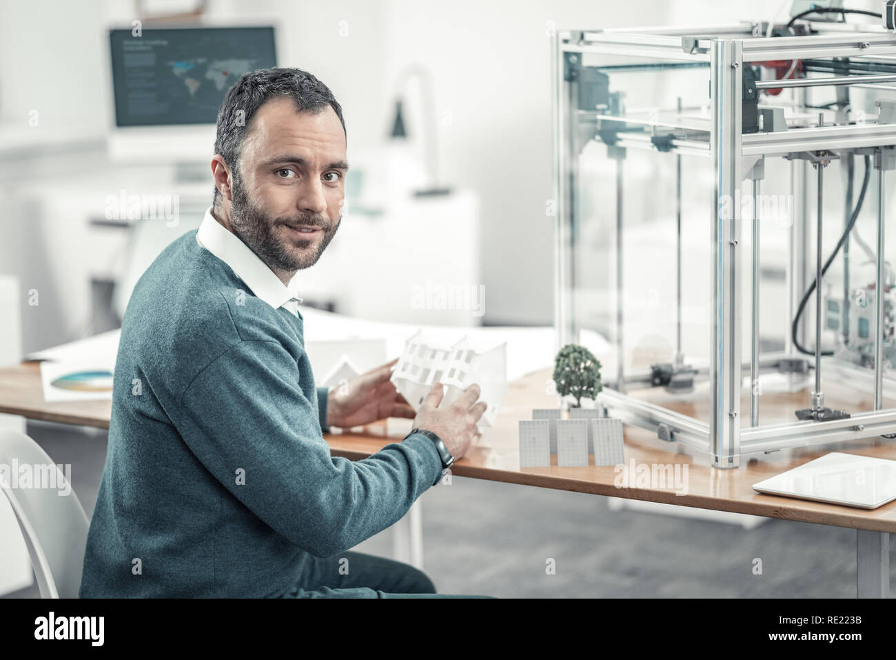 Positive bearded man sitting at the table Stock Photo
