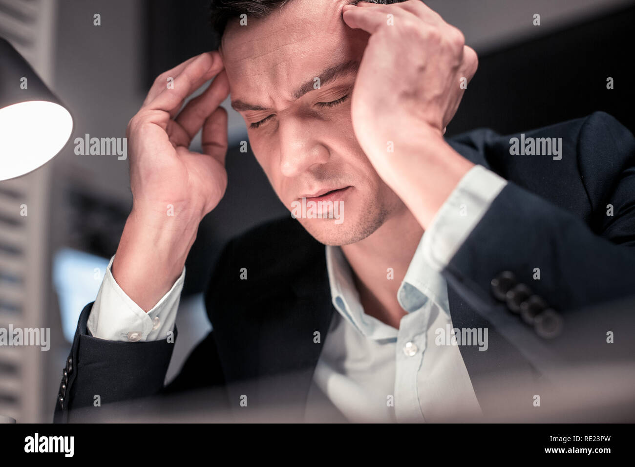 Smart handsome nice man closing his eyes - Stock Image