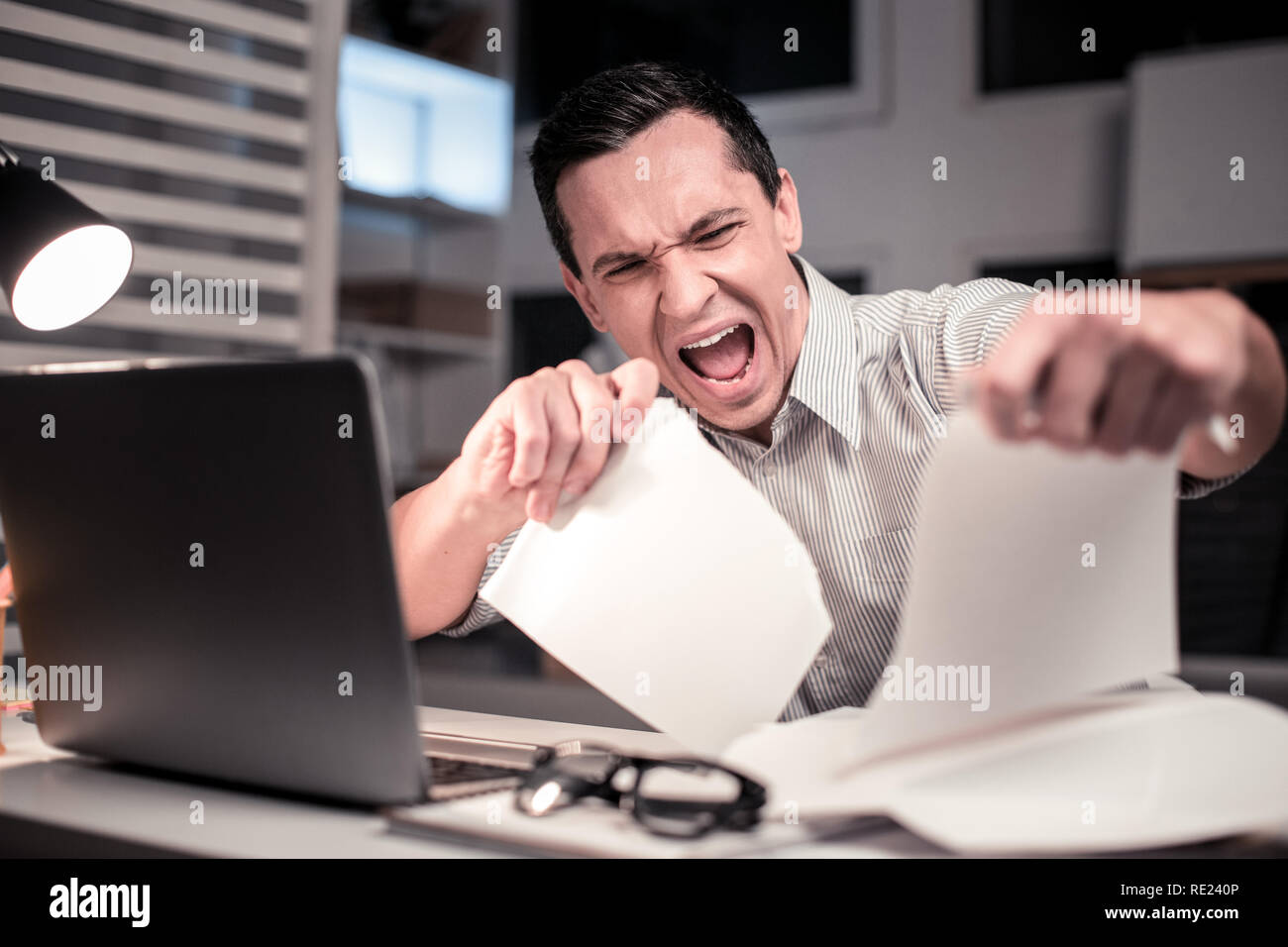 Angry cheerless adult man expressing his emotions - Stock Image
