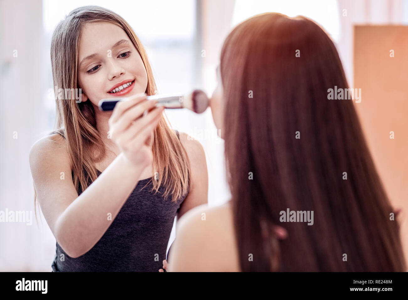 Inspired two girls getting rid of redness - Stock Image