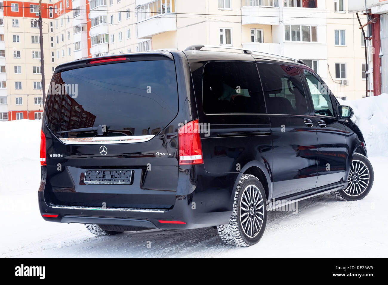 Novosibirsk, Russia - 08.01.2018: Rear view of new a expensive Mercedes Benz V-class minivan bumper and trunk of a car, a long black limousine, model  - Stock Image