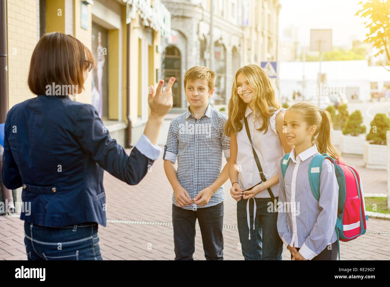 Outdoor portrait group of students with female teacher . - Stock Image