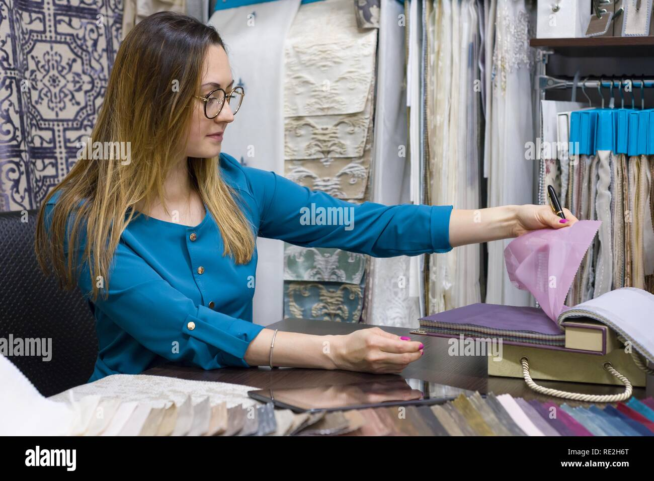 Woman Owns A Store Of Interior Fabrics And Decor Works With Samples Of Materials Small Business Home Textile Shop Stock Photo Alamy