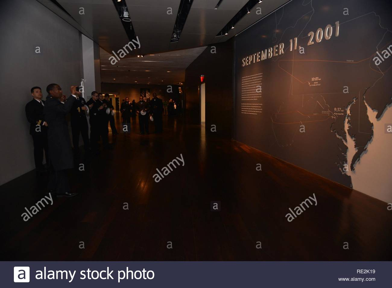 NEW YORK (Nov. 12, 2016) - Sailors attached to amphibious assault ship USS Iwo Jima (LHD 7) view the introductory exhibition at the National 9/11 Memorial & Museum at the World Trade Center. Iwo Jima is participating in Veterans Week New York City 2016 to honor the service of all our nation's veterans. The ship recently returned from the humanitarian assistance mission to Haiti in the aftermath of Hurricane Matthew - Stock Image