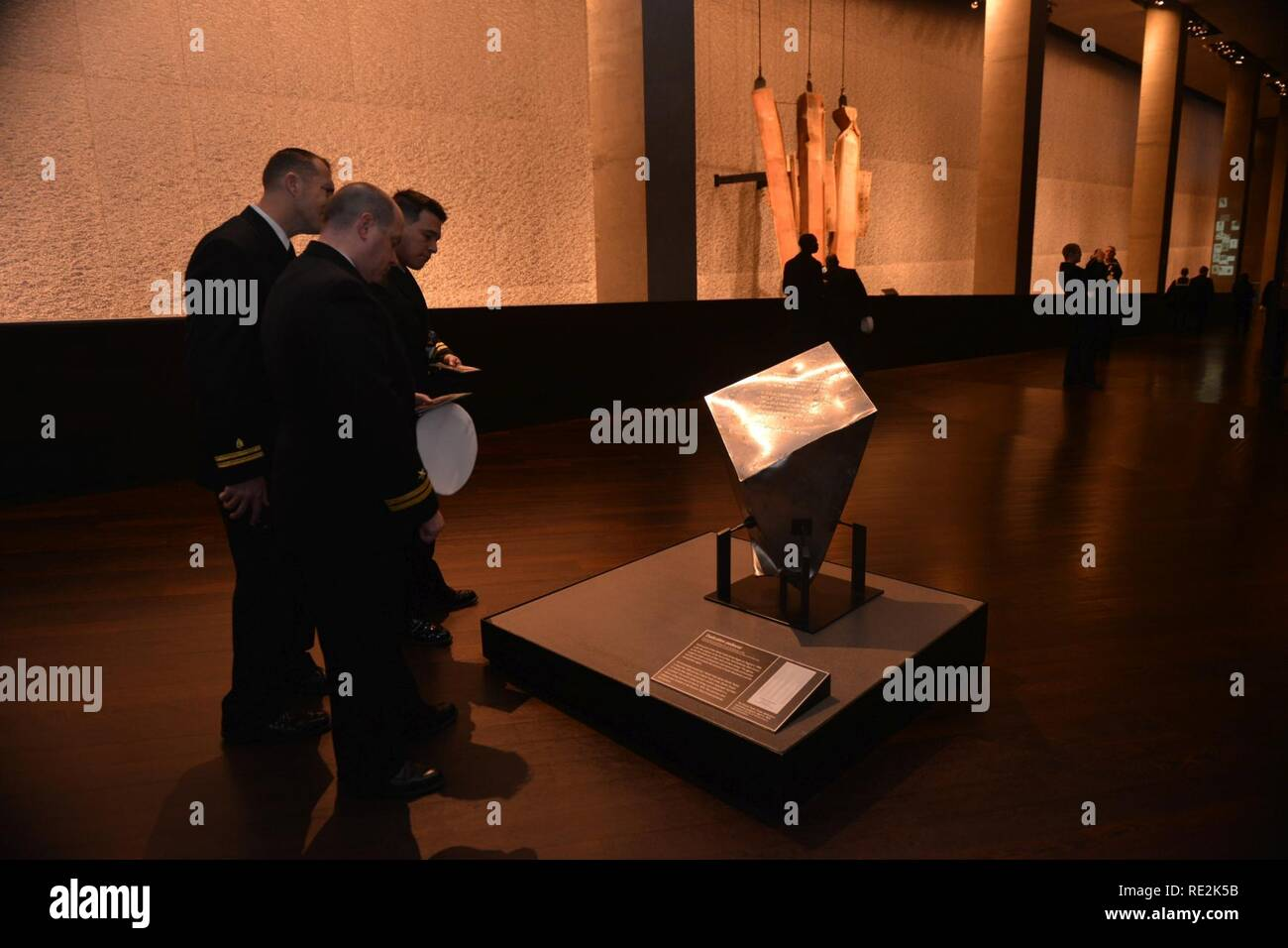 NEW YORK (Nov. 12, 2016) - Sailors attached to amphibious assault ship USS Iwo Jima (LHD 7) view the Dedication Pedestal at the National 9/11 Memorial & Museum at the World Trade Center. Iwo Jima is participating in Veterans Week New York City 2016 to honor the service of all our nation's veterans. The ship recently returned from the humanitarian assistance mission to Haiti in the aftermath of Hurricane Matthew - Stock Image