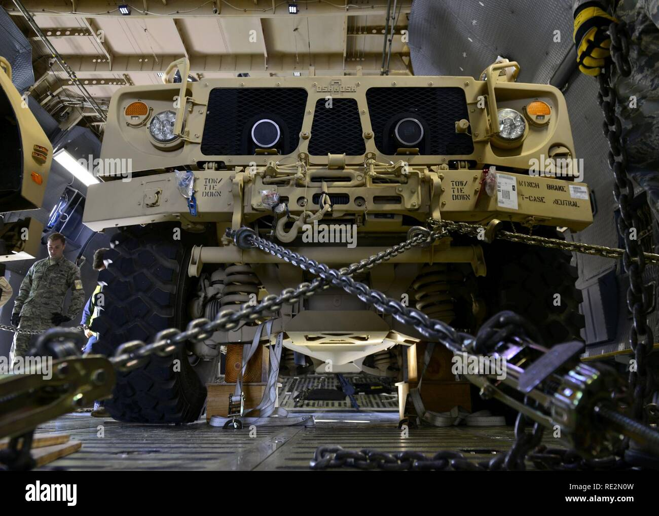 An all-terrain vehicle sits inside a C-5M Super Galaxy at Aviano Air Base, Italy on Nov. 8 2016. Several vehicles were secured with chains and supports to prevent movement during transport to Iraq. - Stock Image