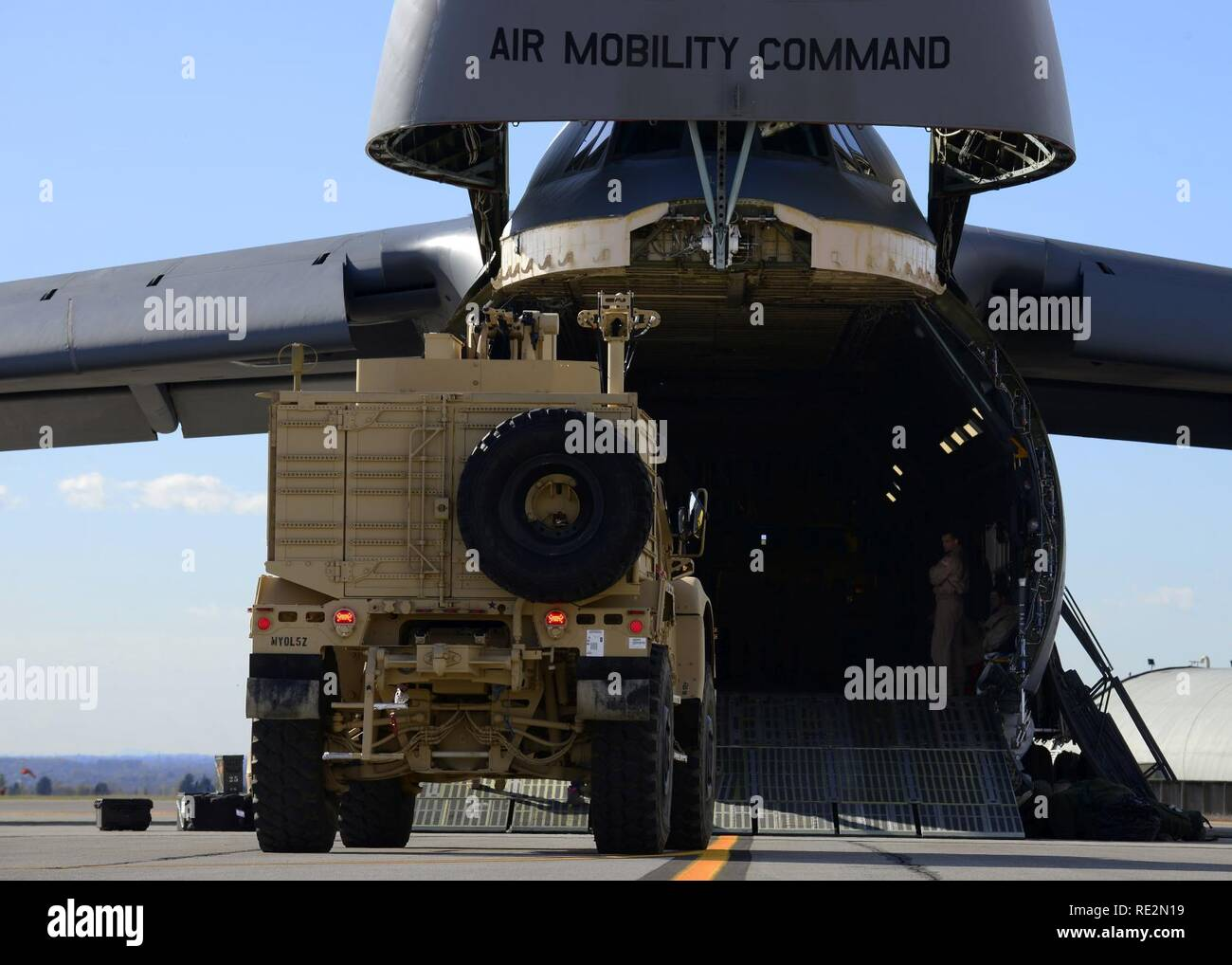 An all-terrain vehicle is driven into a C-5M Super Galaxy at Aviano Air Base, Italy on Nov. 8, 2016. 724th Air Mobility Squadron personnel loaded the vehicles and other cargo into the C-5M for transport to Iraq. - Stock Image