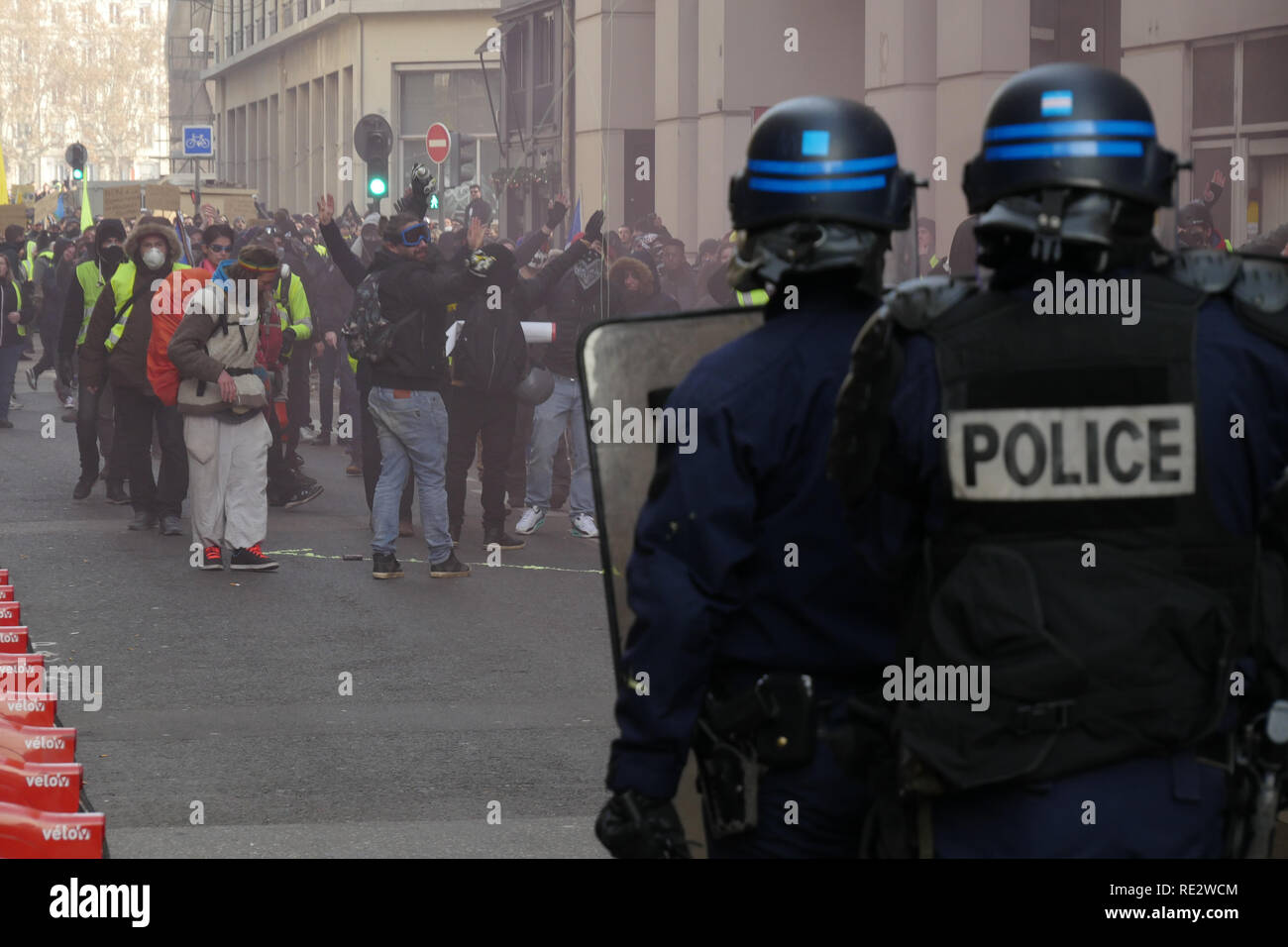 Lyon, France, January 19th 2019: Riot police officers use tear gas cannisters to push back Yellow jackets as they take part to the 10th day of protest against french goverment reform projetct. in Lyon (Central-Eastern France) on january 19, 2019  Credit Photo: Serge Mouraret/Alamy Live News - Stock Image
