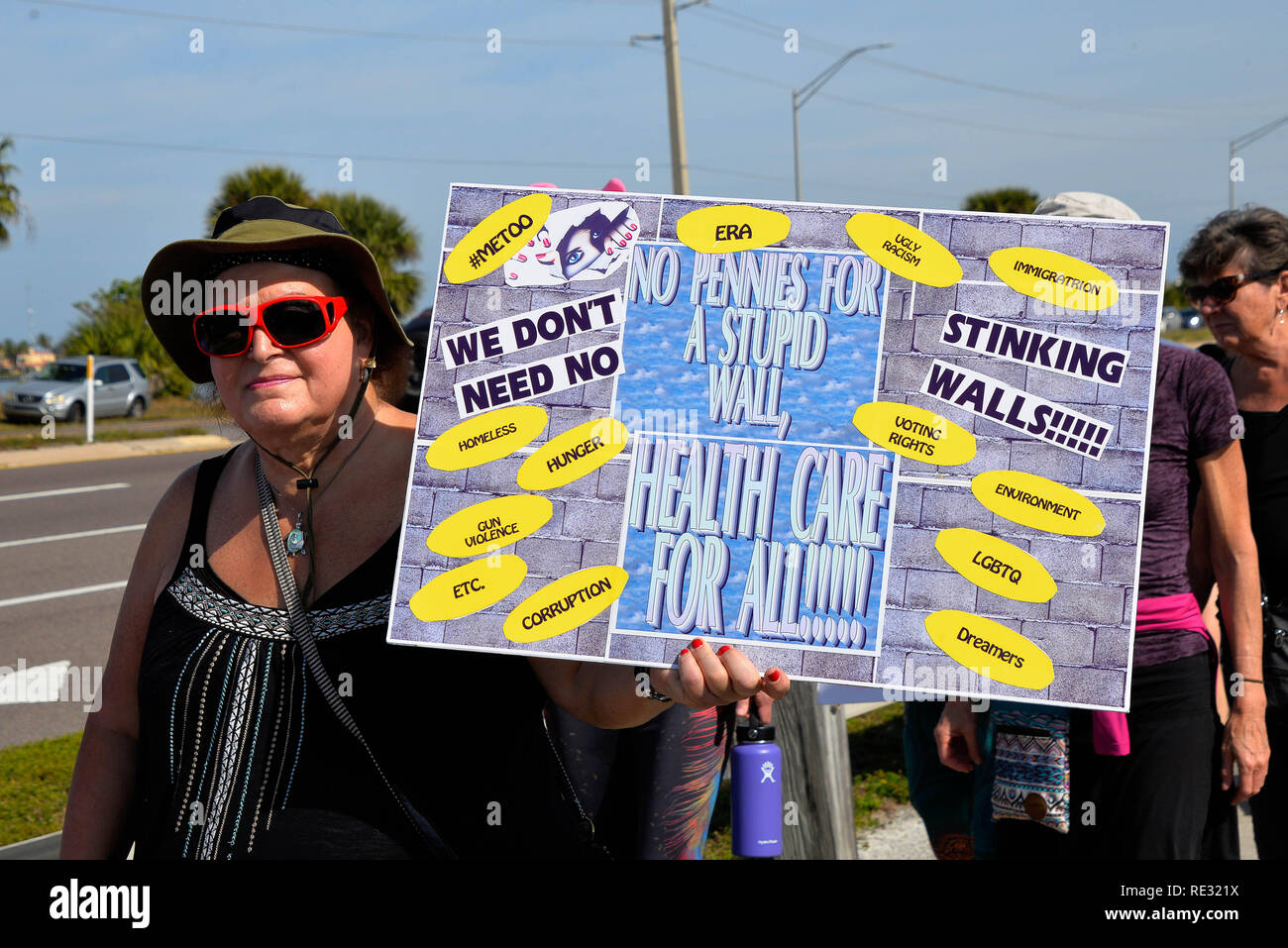 "Melbourne, Florida. USA. January 19, 2019. Hundreds of banner waving demonstrators marched across the Eau Gallie Causeway in the 2019 Woman's March, who's 2019 mission is ""Truth to Power. Holding our Politicians accountable"" Marches have been held though out America this weekend.  The Women's March is a national movement to unify and empower everyone who stands for human rights, civil liberties, and social justice for all. Photo Credit Julian Leek / Alamy Live News - Stock Image"