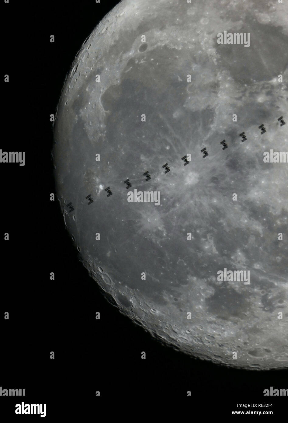 Cologne, Germany. 19th Jan 2019.  The International Space Station ISS passes the moon and thus becomes visible for a short time as a silhouette (multiple exposure). Photo: Henning Kaiser/dpa Credit: dpa picture alliance/Alamy Live News - Stock Image