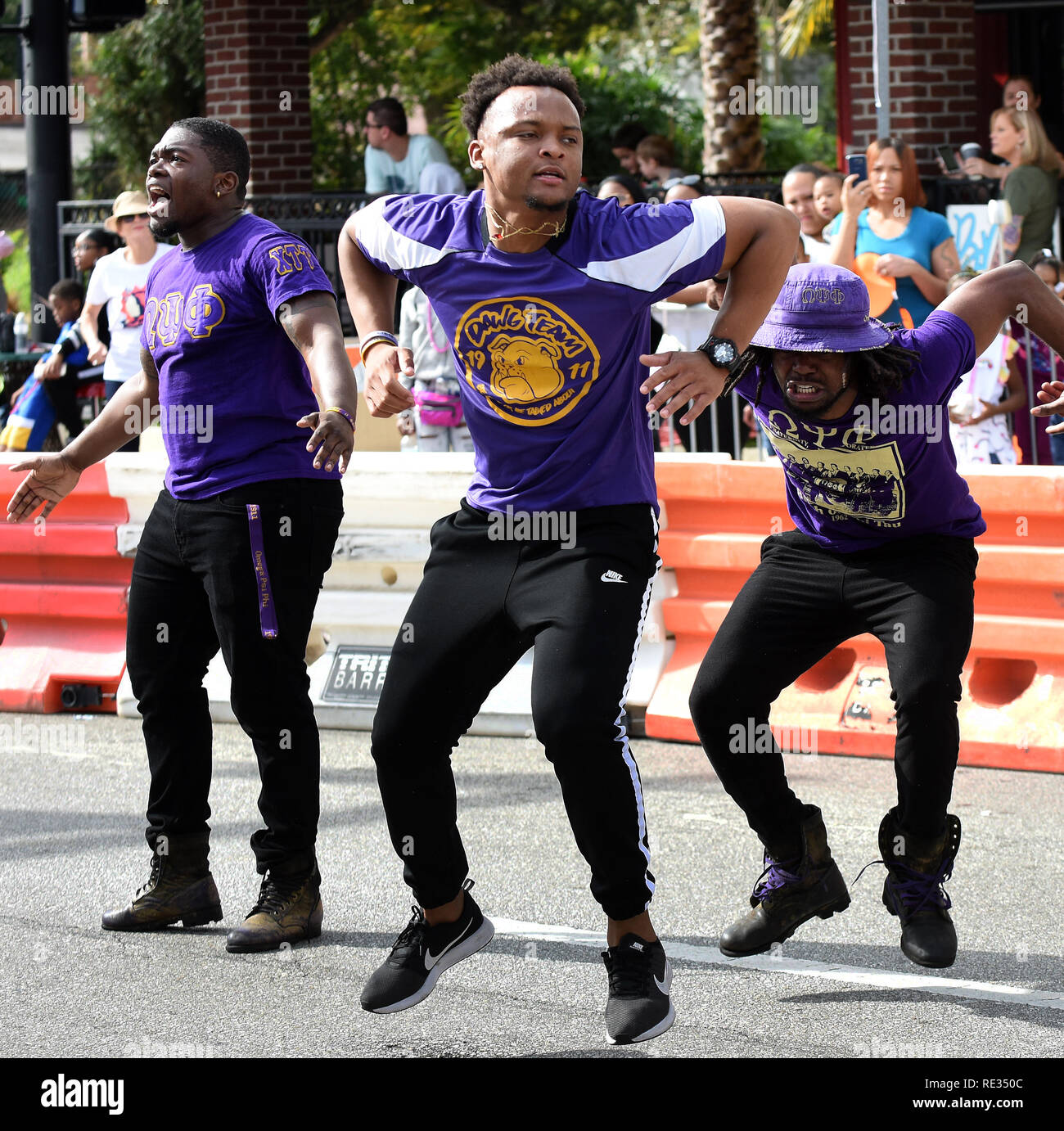 Florida, USA. 19th Jan 2019. Members of the Omega Psi Phi fraternity Que Doggs perform a dance in the annual Dr. Martin Luther King, Jr. Day Parade on January 19, 2019 in Orlando, Florida. (Paul Hennessy/Alamy) Credit: Paul Hennessy/Alamy Live News - Stock Image