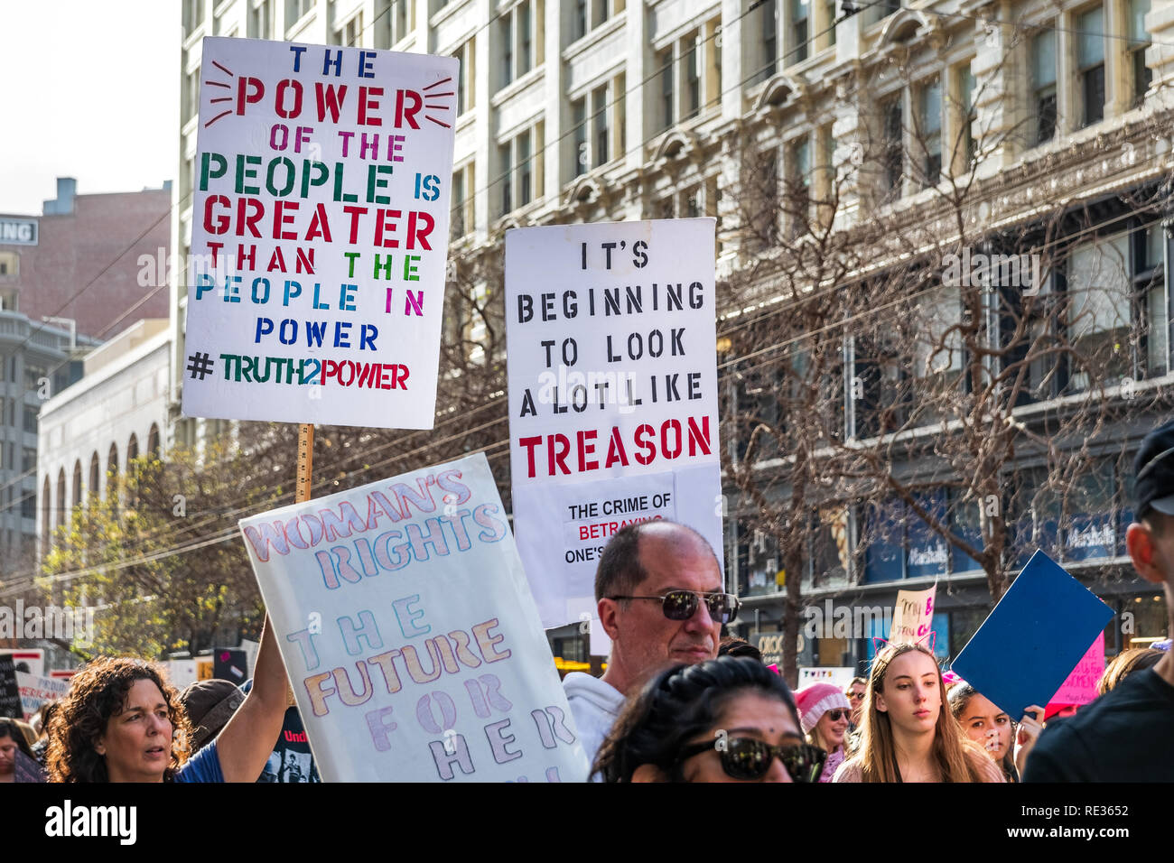 San Francisco, USA. 19th Jan 2019.  Participants to the Women's March event hold signs with various massages while marching on Market street in downtown San Francisco - Stock Image