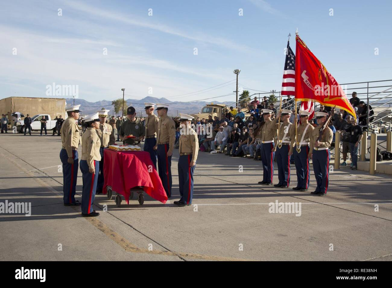 (Left) Sergeant Moises Machuca; Cpl. Kristina Zamora, Lt. Col. Timothy Silkowski, director, Fleet Support Division, stand ready as 63-year-old retired Gunnery Sgt. Leland Snouffer, security, Production Plant Barstow, representing the oldest Marine at PPB, accepts the piece of ceremonial birthday cake and prepares to pass it on to the youngest Marine present, 20 year old Pfc. Jacob Sotto, FSD, as coporals John Teale and Victor Manriquez stand at attention during the celebration of the 241st birthday of the founding of the Marine Corps, Nov. 7. - Stock Image