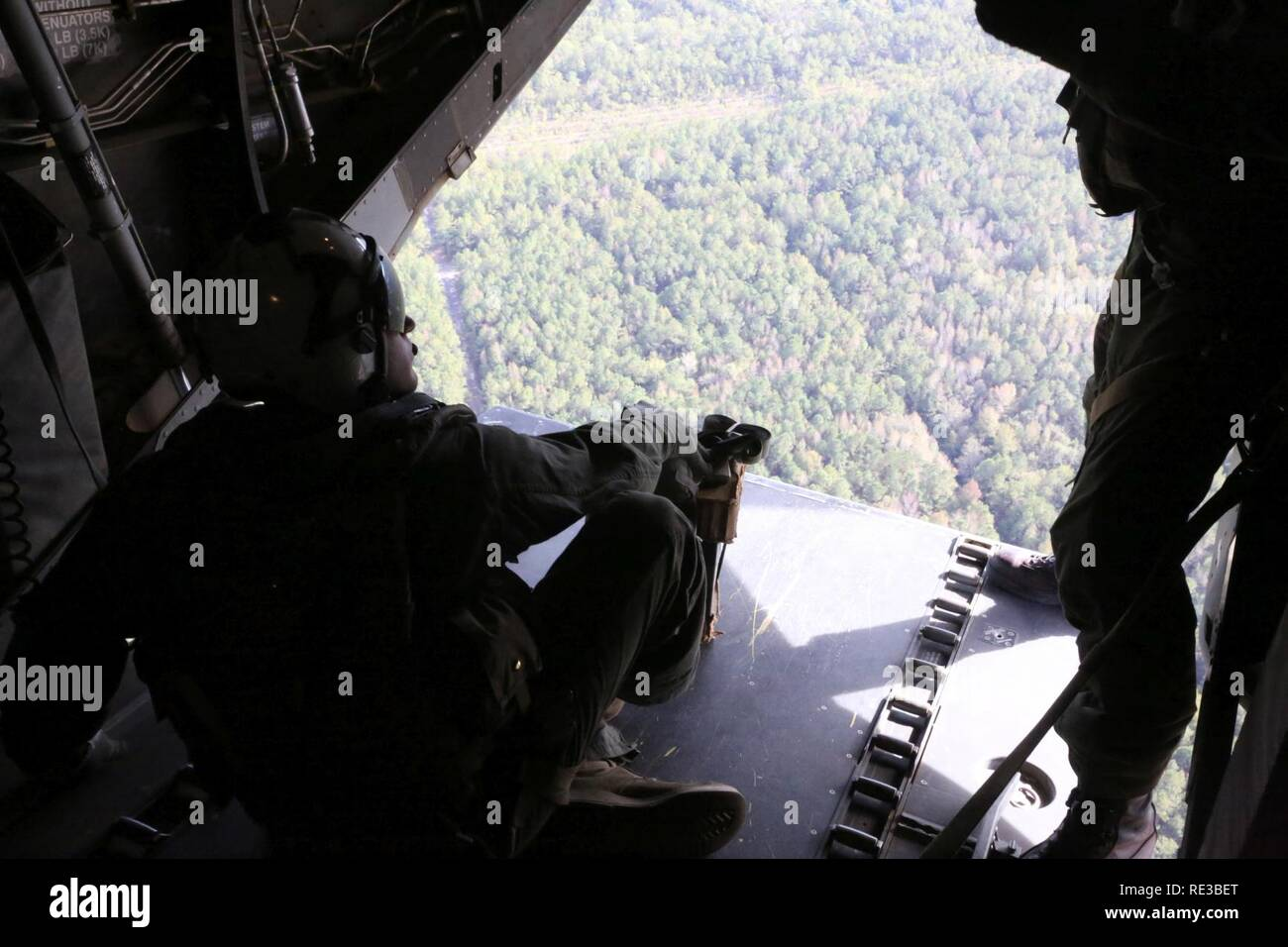 Cpl  Joshua Mikalunas prepares to drop a package with a parachute