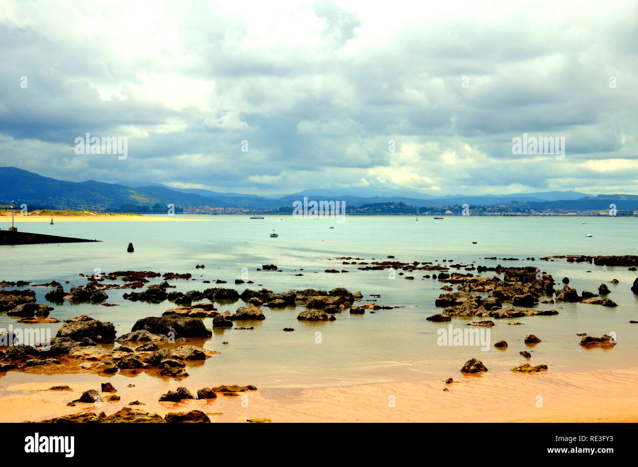 Image of one of the beaches of Asturias at low tide, Cantabria, Spain - Stock Image