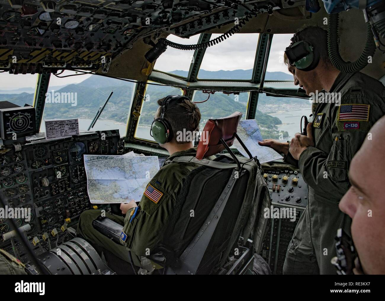 36th Airlift Squadron C-130H navigators confirm charted flight path during Keen Sword 2017 on Nov. 10, 2016, over the Shikoku prefecture, Japan. Approximately 11,000 U.S. service members in the Indo-Asia-Pacific region are scheduled to participate in Keen Sword 2017. - Stock Image