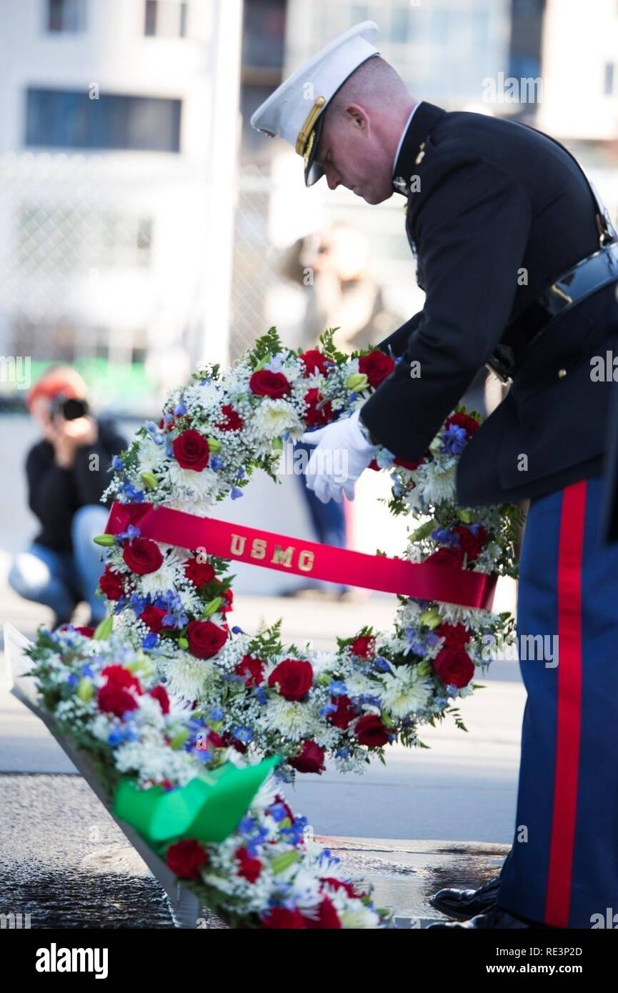 Major James F. Colvin- assistant S-3 officer, 25th Marine Regiment, 4th Marine Division, lays a wreath representing the United States Marine Corps during a Veterans Day ceremony at the Massachusetts Fallen Heroes Memorial in Boston, Nov. 11, 2016. During the ceremony, five wreaths were laid at the foot of the memorial to represent each branch of the military. The memorial stands tall in Boston's Seaport Park and serves as a public space for reflection and remembrance of those who gave their lives fighting for our freedom in the Global War on Terrorism. - Stock Image
